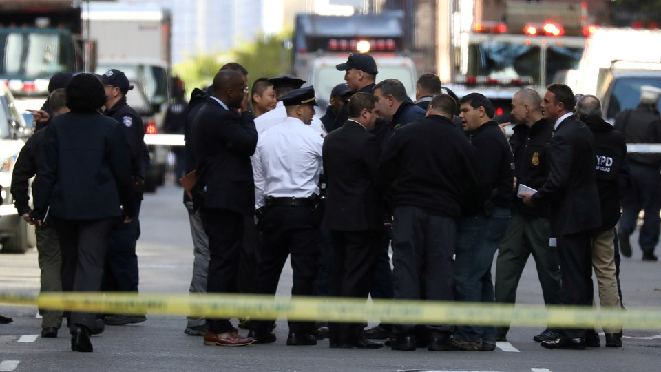 Police stand outside of the Time Warner building after a suspicious package was found inside CNN Headquarters