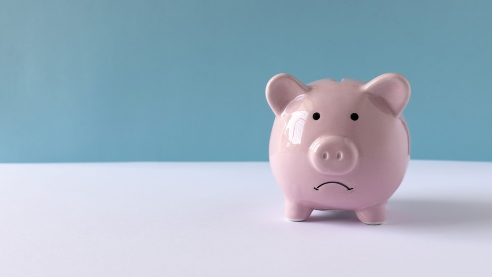 A piggy bank with a frowning face