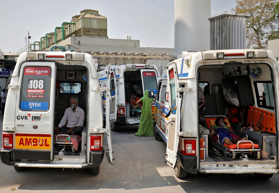 Several ambulances sit parked with patients inside.