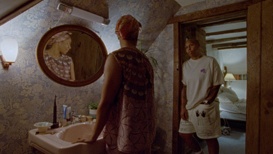 A couple talks to each other in their home bathroom.