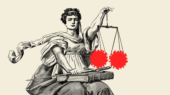 An illustration of Lady Justice holding up two coronavirus cells on the scales of justice