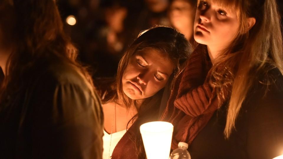 A student at Umpqua Community College mourns during a vigil in Roseburg, Oregon, on October 1, 2015.