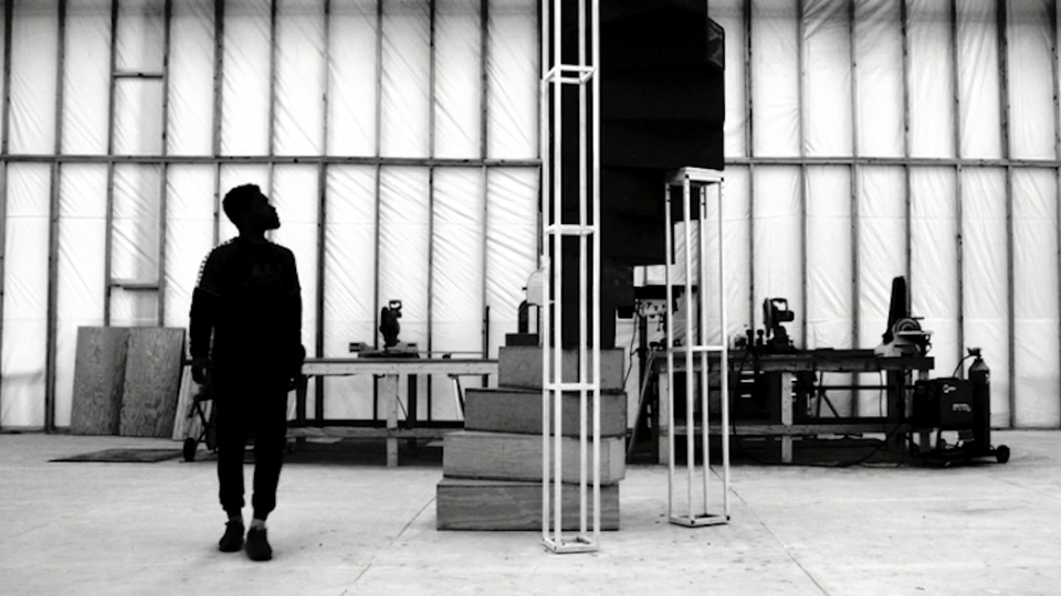 Frank Ocean looks up at his spiral staircase