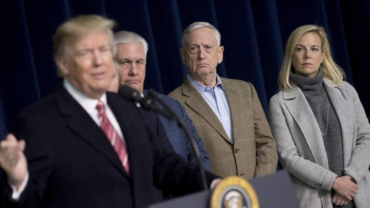 Rex Tillerson, James Mattis, and Kirstjen Nielsen watch Donald Trump.