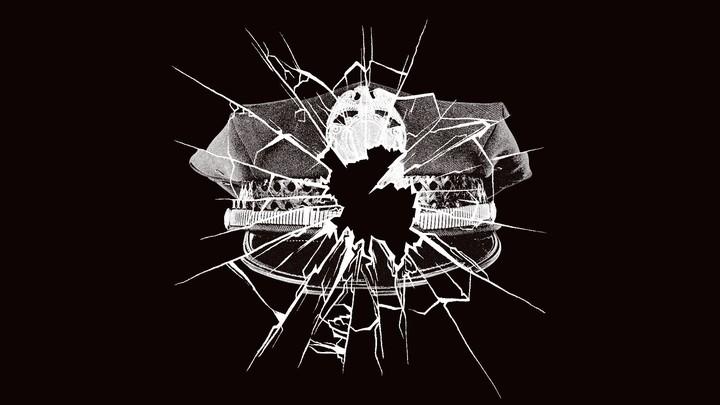 Police-officer hat and broken window