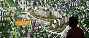 A prospective buyer looks at a rendering of a new apartment complex in Seoul in 2005.