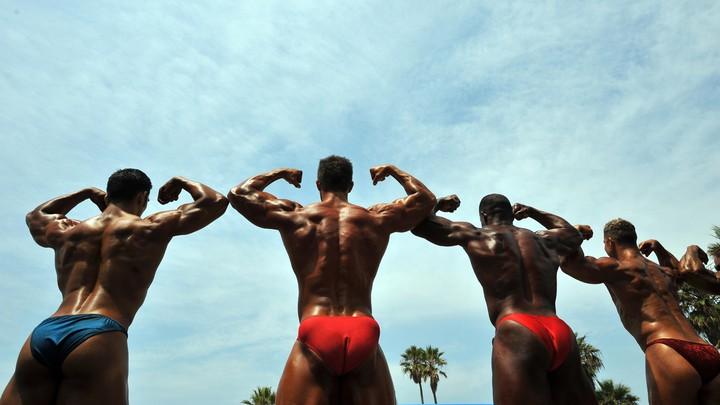 Men flex during a bodybuilding event in California.