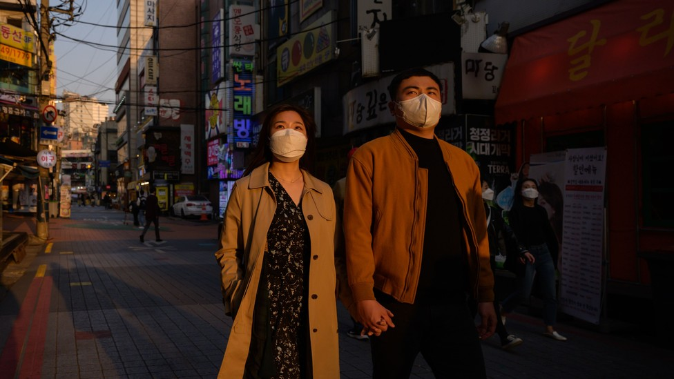 A couple in South Korea wearing facemasks