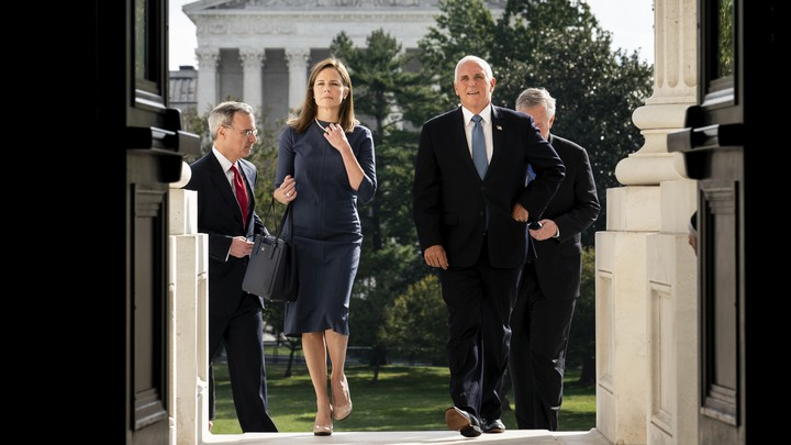 Judge Amy Coney Barrett and Vice President Mike Pence walk into the Capitol.