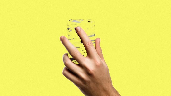 A person's hand holding a phantom phone.