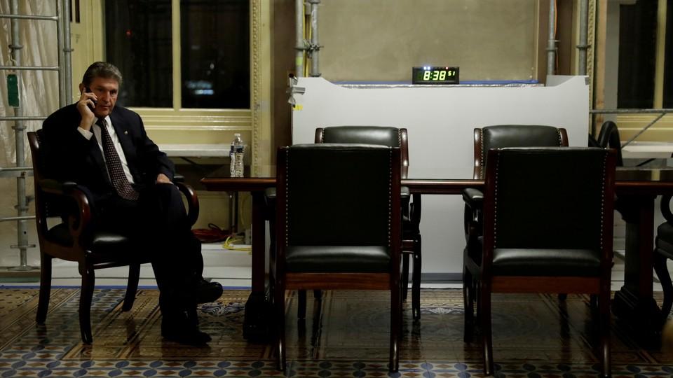 West Virginia Senator Joe Manchin takes a phone call.