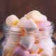 Mini multicolored marshmallows in a glass jar