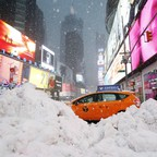 A taxi stuck in snow