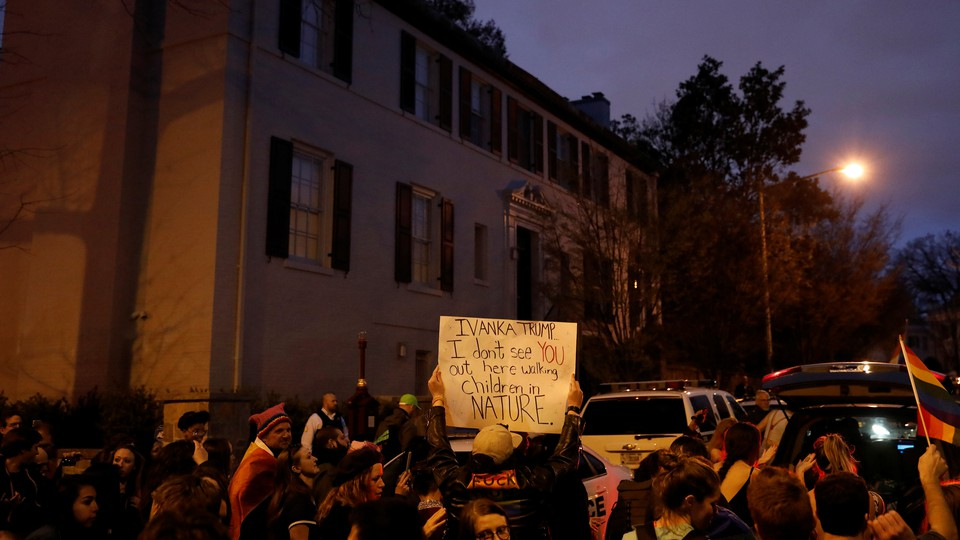 Protesters rally outside the home of Ivanka Trump on April 1, 2017.