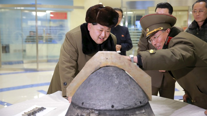 North Korean leader Kim Jong Un looks at the tip of a rocket warhead after a simulated test of atmospheric reentry of a ballistic missile.