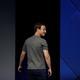 Mark Zuckerberg looks over his shoulder.