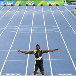 Jamaica's Usain Bolt poses after winning the gold.