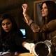 Amita (Mindy Kaling) and Debbie (Sandra Bullock) examine counterfeit jewels in 'Ocean's 8'