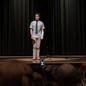 Evan Hansen, in the film 'Dear Evan Hansen,' on a stage, being filmed on a cellphone