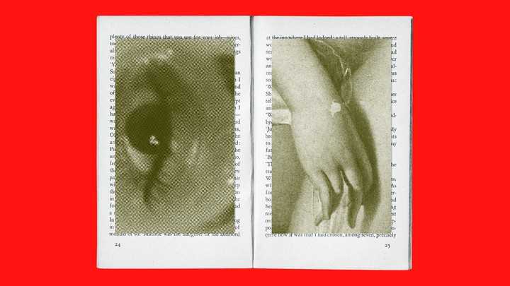 open book with images of an eye and a hand juxtaposed on top of the pages