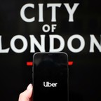 photo: Uber app and sign for City of London