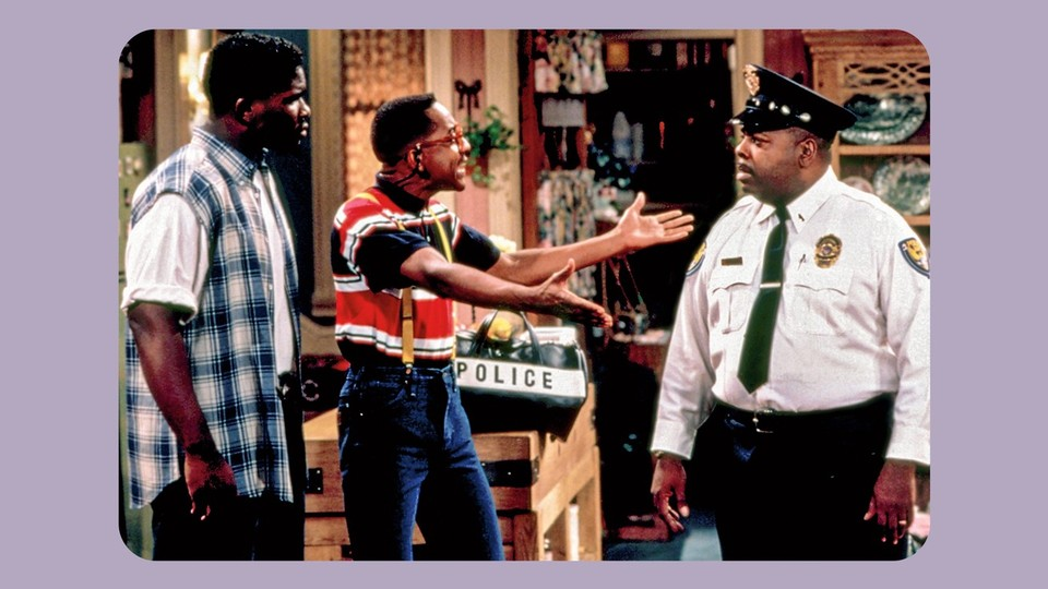 """Eddie Winslow, Steve Urkel and Carl Winslow stand in the living room of the set of """"Family Matters"""""""
