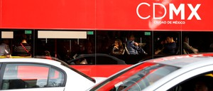Commuters ride on one of Mexico City's new smog-free double-decker buses.