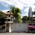 An exterior shot of the late Lee Kuan Yew's residence shows its proximity to downtown skyscrapers.