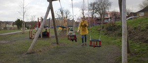 photo: A mother and her child at a playground in London's West Norwood,