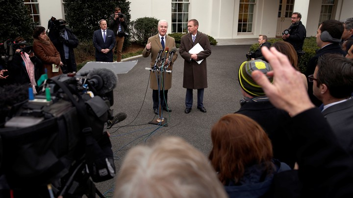 Secretary of Health and Human Services Tom Price and Mick Mulvaney, director of the Office of Management and Budget, speak to reporters outside the White House on Monday.