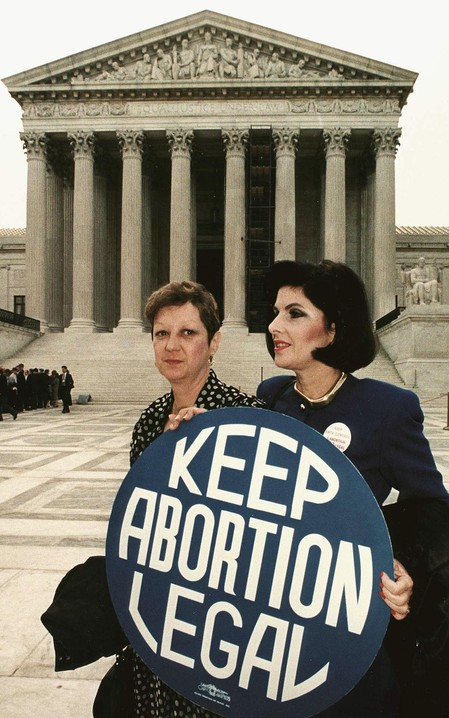 A photo of McCorvey with attorney Gloria Allred in front of the U.S. Supreme Court, 1989