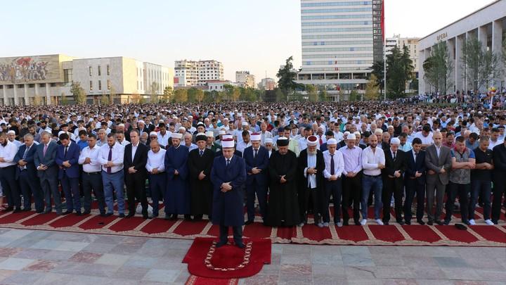 Men gather in Skanderbeg Square in Tirana, Albania, for the Eid al-Fitr prayer service to mark the end of Ramadan in 2017.