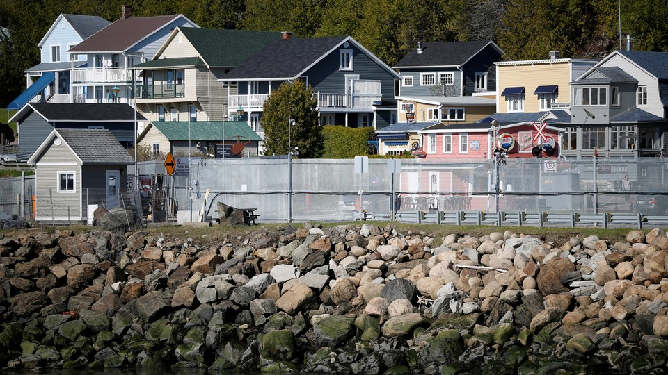 A security fence along the waterfront near the upcoming G7 summit in Charlevoix, Quebec