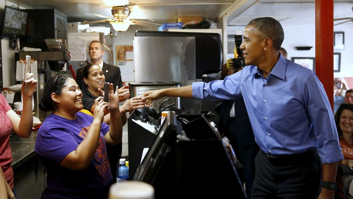 President Barack Obama shakes hands with restaurant employees