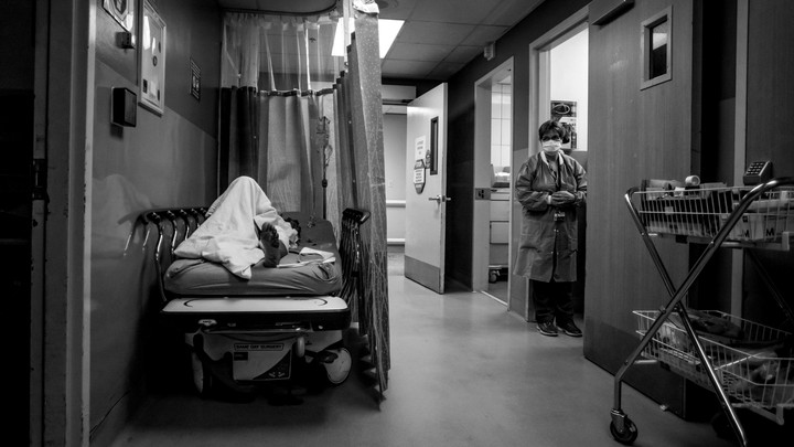 A patient rests in a corridor, waiting for a room at Providence Cedars-Sinai Tarzana Medical Center in California on January 3, 2021.