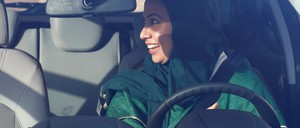 A Saudi woman sits in a car during driver's training at a university in Jeddah.