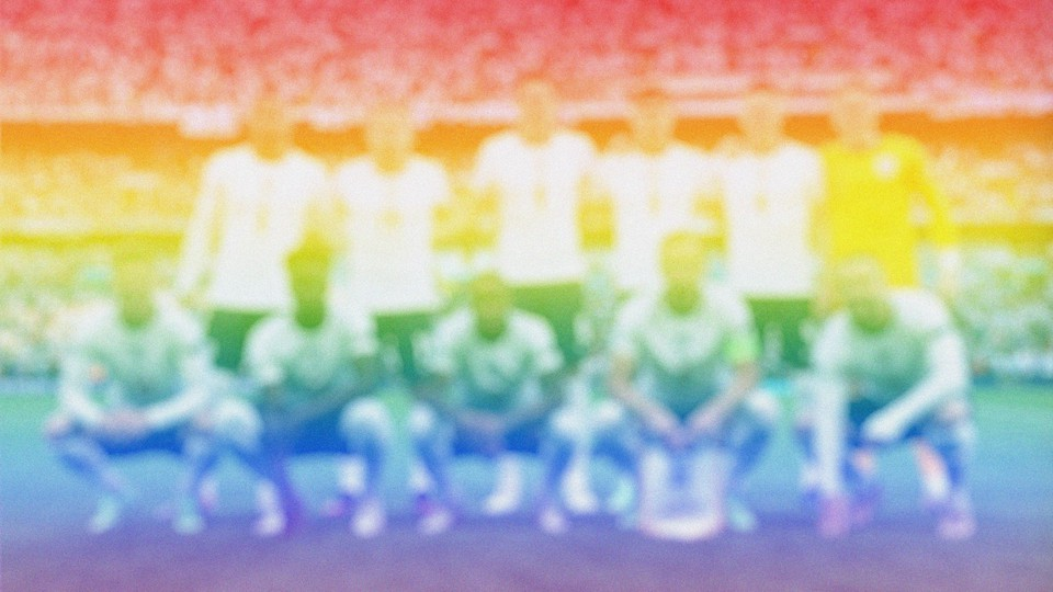 England's national men's soccer team blurred in rainbow colors