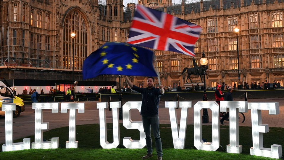 An anti-Brexit protester demonstrates in front of Parliament.