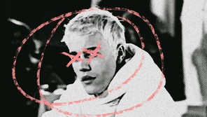 grainy photo of Justin Bieber with his head circled and the eyes X'd out