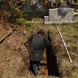 Jesus Torres digs graves at La Piedad cemetery in McAllen, Texas
