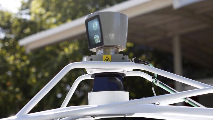 A sensor spins atop a Google self-driving vehicle