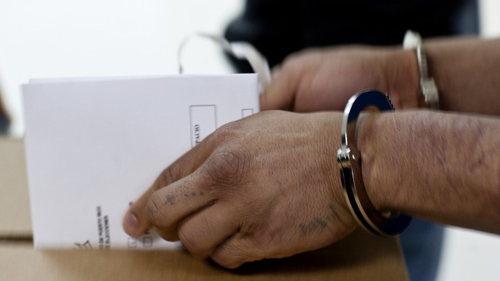 An inmate casts his ballot ahead of a referendum in Bayamón Correctional Complex, in Puerto Rico.