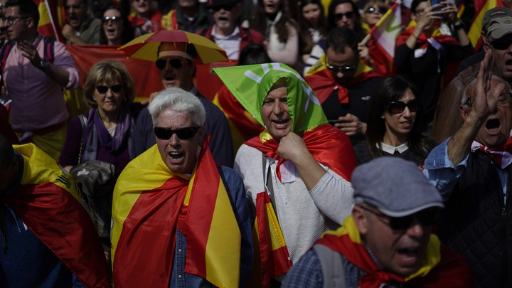 Vox supporters attend a rally in Barcelona in March 2019.