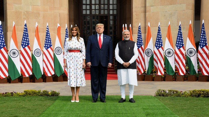 U.S. President Donald Trump and first lady Melania Trump pose with Indian Prime Minister Narendra Modi in New Delhi.