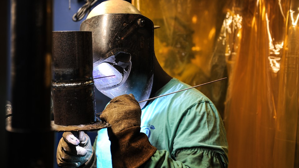 A welder is seen working.