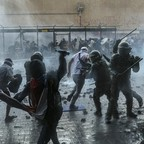 photo: Chilean police clash with anti-government demonstrators during a protest in Santiago, Chile.