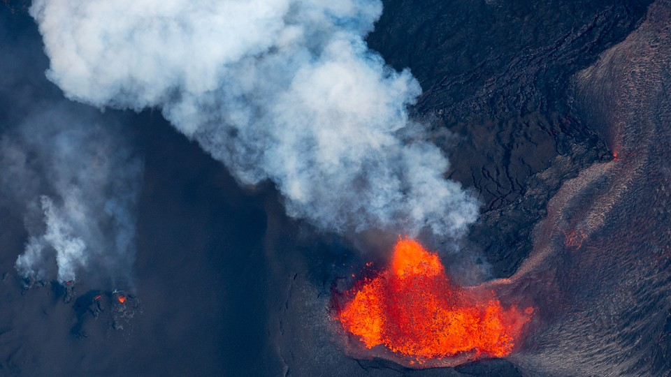 A volcano spewing red and orange lava