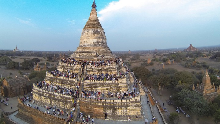 People wait to see the sunset from atop the Shwesandaw Pagoda in Bagan, Myanmar, on February 13, 2015.