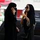 Saudi women speak on their phones in Riyadh.