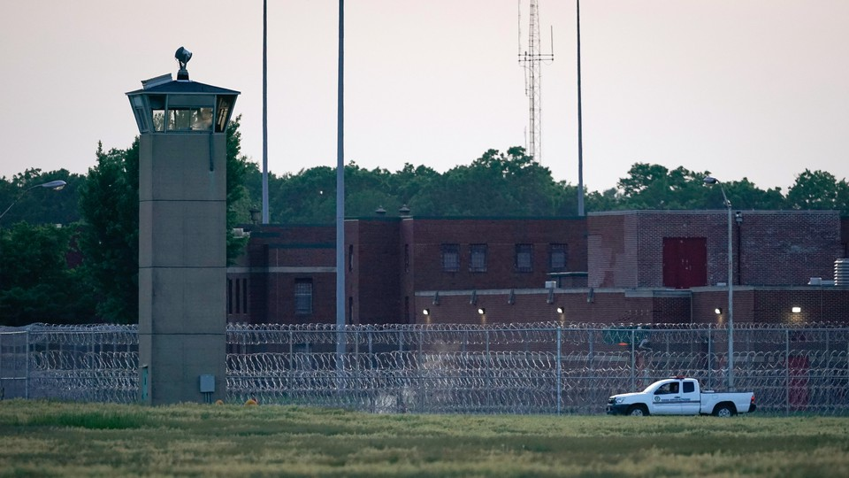 A corrections vehicle patrolled near the Federal Corrections Complex where John Walker Lindh was released from prison today